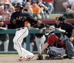 San Francisco Giants' Francisco Peguero drives in two runs with a double against the Arizona Diamondbacks during the sixth inning of an exhibition spring training baseball game on Sunday, March 3, 2013 in Scottsdale. Ariz. (AP Photo/Marcio Jose Sanchez)