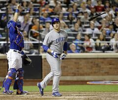 Chicago Cubs' Anthony Rizzo, right, tosses his bat after hitting a pop fly as New York Mets catcher Travis d'Arnaud points to the ball during the seventh inning of a baseball game Saturday, Aug. 16, 2014, in New York. (AP Photo/Frank Franklin II)