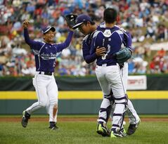 South Korea's Sang Hoon Han, from right, Hae Chan Choi and Ji Ho Park celebrate after defeating Japan 12-3 in the International Championship baseball game at the Little League World Series, Saturday, Aug. 23, 2014, in South Williamsport, Pa.(AP Photo/Matt Slocum)