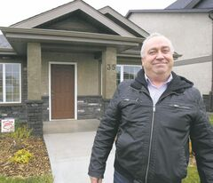 Maximum Realty's Jeff McArthur outside 35 Bellflower Road, a Signature Homes bungalow in Bridgwater Lakes.