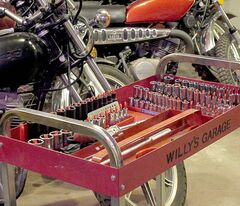 Willy utilizes a cart loaded with the tools he uses on a daily basis.