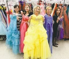 Gowns for Grads chairwoman Lorraine Penman (centre) with volunteers (from left) Erin Herkimer, Lesa Campbell, Margot Kalinowski and Daphne Eva prepare colourful gowns.