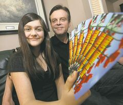 Jenna Sigurdson, with dad, Blair, shows Toonies for Tulips bookmarks to raise funds against Parkinson's.