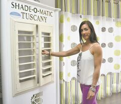 Manager Lindsay Buus with shutters and drapes at Visions Draperies on St. Anne's Road.
