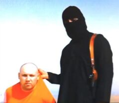 FILE - This image made from video released by Islamic State militants on Aug. 19, 2014 purports to show journalist Steven Sotloff being held by the militant group. On Tuesday, Sept. 2, 2014, an Internet video purports to show the beheading of Sotloff by the Islamic State group. (AP Photo/File)
