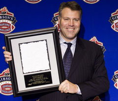 Ron Lancaster Jr., son of CFL great Ron Lancaster, accepting the Commissioners Award on behalf of his deceased father  during the CFL Player Awards in Montreal in 2008.