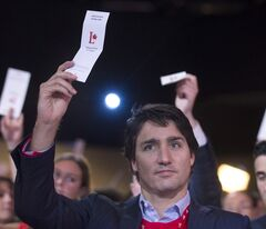 Federal Liberal leader Justin Trudeau votes on a resolution during the party's biennial convention in Montreal, Sunday, February 23, 2014. THE CANADIAN PRESS/Graham Hughes