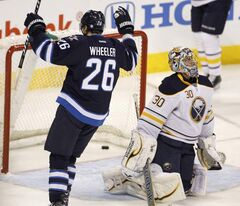 Winnipeg Jets' Blake Wheeler (26) celebrates a goal by Andrew Ladd against Buffalo.