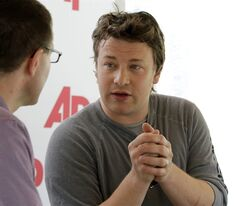 Celebrity chef Jamie Oliver, right, talks with J.M. Hirsch, food editor for The Associated Press.