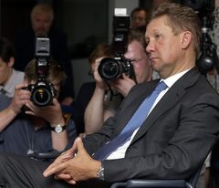 Alexey Miller, front, CEO of the Russian energy supplier Gazprom, attends a press conference as part of a meeting of the European Union energy commissioner Guenther Oettinger and Russia's and Ukraine's energy ministers in Berlin, Germany, Monday, May 26, 2014. (AP Photo/Michael Sohn)