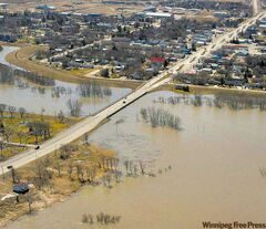 An aerial view of the Morris dike as it holds back rising flood waters on Monday.