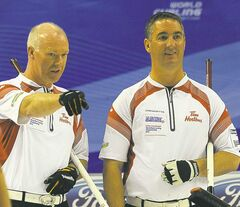 Canadian skip Glenn Howard and third Wayne Middaugh (right) are old pals.