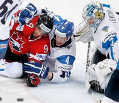 Canada's Evander Kane scuffles with Finland's Mikael Granlund as goalkeeper Kari Lehtonen watches closely on Friday in Helsinki.