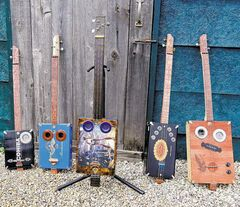 Wayne Seepish's cigar-box guitars come in various sizes — depending on what kind of cigar boxes he can get his hands on.