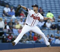 Atlanta Braves starting pitcher Mike Minor (36) works in the first inning of a baseball game against Milwaukee Brewers Monday, May 19, 2014 in Atlanta. (AP Photo/John Bazemore)