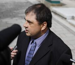 Winnipeg resident Richard Hykawy met with the media outside the provincial court on Friday, after the trial into the care of the boulevard bordering his property was adjourned.