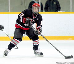 Killarney's Reid Gow moves the puck up the ice for the Southwest Cougars.
