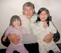 Reginald Blackbird is seen with his granddaughters in a family photo.  He was struck by a car and killed on Christmas Eve, 2010.