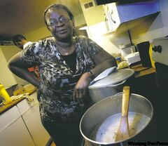 Frances Fosonah, originally from Sierra Leone, in the kitchen of her St. Vital home.