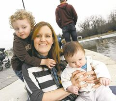 Stacey Nattress with her sons, Max Brown, 3, and Jackson Brown, three months, enjoying the duck pond at Assiniboine Park.