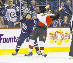 Jet's Anthony Peluso tangles with Sens' Michael Sdao.
