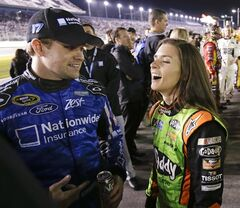Drivers Ricky Stenhouse Jr., left, and Danica Patrick get together on pit road before the NASCAR Sprint Unlimited auto race at Daytona International Speedway in Daytona Beach, Fla., Saturday, Feb. 15, 2014. (AP Photo/John Raoux)