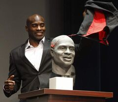 Former Winnipeg Blue Bombers receiver Milt Stegall unveils his bust at a Canadian Football Hall of Fame ceremony at the McPhillips Street Station.