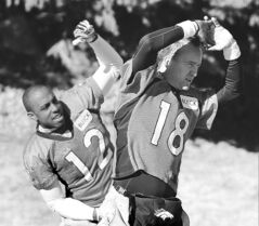 Denver Broncos quarterback Peyton Manning (18) and wide receiver Andre Caldwell stretch during practice at the team's training facility in Englewood on Friday.