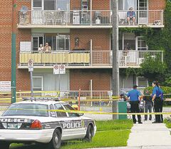 The taped-off homicide scene on June 20, 2012.