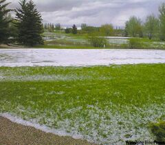 Hail turns the South Interlake Golf and Country Club near Warren into a winter wonderland during a tournament Saturday afternoon.