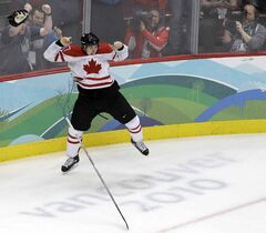 Canada's Sidney Crosby leaps in the air in celebration after scoring the game-winning goal in overtime of the men's gold medal ice hockey game against the United States at the Vancouver 2010 Olympics in Vancouver, British Columbia.