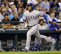 Texas Rangers' Elvis Andrus heads home to score against the Seattle Mariners in the fourth inning of a baseball game Monday, Aug. 25, 2014, in Seattle. (AP Photo/Elaine Thompson)