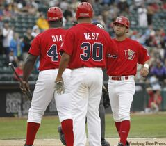 Goldeyes outfielder Justin Justice (right) was a great pickup and sluggers Juan Diaz and Kevin West are pitching in at the plate.