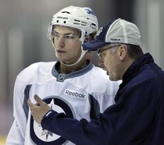Forward Alexander Burmistrov gets some instruction from head coach Claude Noel. Burmistrov's problem is inconsistency.