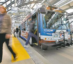 Riders board new rapid transit bus Sunday.