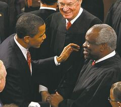 U.S. President Barack Obama greets Supreme Court Justice Clarence Thomas before his address to a joint session of Congress in 2009.