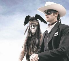 This undated publicity photo from Disney/Bruckheimer Films, shows actors, Johnny Depp, left, as Tonto, a spirit warrior on a personal quest, who joins forces in a fight for justice with Armie Hammer, as John Reid, a lawman who has become a masked avenger, The Lone Ranger, from the movie,
