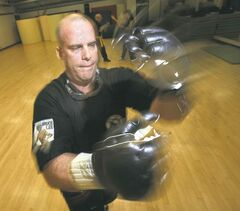 Former Winnipeg Blue Bomber Brett MacNeil demonstrates the martial art Wing Chun Do, which was created by Bruce Lee.
