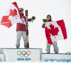 Gold medallist Dara Howell, left, and bronze medallist Kim Lamarre, both of Canada, celebrate their wins in the women's ski slopestyle final at the Sochi Winter Olympics in Krasnaya Polyana, Russia, Tuesday, Feb. 11, 2014. THE CANADIAN PRESS/Jonathan Hayward