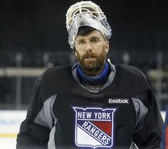 New York Rangers goalie Henrik Lundqvist of Sweden leaves the ice after participating in an optional practice for Game 4 of the Stanley Cup Finals at Madison Square Garden in New York, Tuesday, June 10, 2014. The Los Angeles Kings have a 3-0 lead over the Rangers in the best-of-seven series. (AP Photo/Kathy Willens)