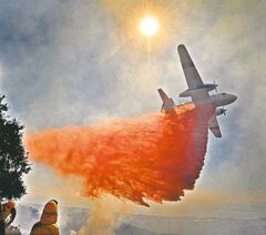 Firefighters battle a wildfire in hills overlooking Santa Barbara, Calif.