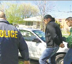 Sean Wolfe is arrested in December 2009 during Project Divide.