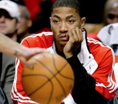 FILE - In this Oct. 19, 2009, file photo, Chicago Bulls' Derrick Rose sits on the bench watching his team during the fourth quarter of their preseason NBA basketball game and 101-98 loss to the Orlando Magic. Rose is out for the season. The team said Monday, Nov. 25, 2013, that Rose had successful surgery to repair a torn medial meniscus in his right knee. Rose was hurt Friday night at Portland. (AP Photo/Charles Rex Arbogast, File)
