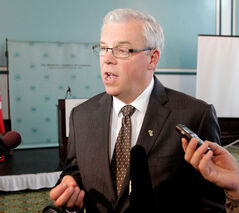 NDP Leader Greg Selinger speaks to reporters after a speech on Manitoba Hydro's future at a Manitoba Chambers of Commerce event in Winnipeg on Thursday.