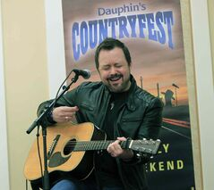 Deric Ruttan performs a few songs at an event Monday to announce Dauphin's Countryfest 2014 lineup. Ruttan will perform at the June festival along with Blake Shelton, The Band Perry, Nitty Gritty Dirt Band and Rascal Flatts.