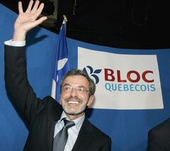 Raymond Gravel waves to supporters after he won the federal byelection in the Repentigny riding for the Bloc Quebecois, in Repentigny, Que., on November 27, 2006. Father Raymond Gravel, a priest engaged in very public and pastoral life, died Monday as a result of lung cancer at the age of 61. THE CANADIAN PRESS/Ian Barrett