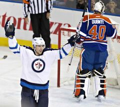 Winnipeg Jets' Blake Wheeler (26) celebrates a goal against Edmonton Oilers goalie Devan Dubnyk (40) during first-period NHL hockey action in Edmonton Tuesday.