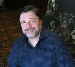 Actor Nathan Lane smiles during an interview at the Banff World Media Festival in Banff, Alta., Wednesday, June 11, 2014. THE CANADIAN PRESS/Bill Graveland