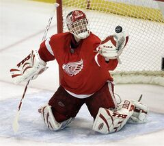 In this April 3, 2008 file photo, Detroit Red Wings goalie Dominik Hasek, of the Czech Republic, stops a Columbus Blue Jackets' Rick Nash shot in the first period of an NHL hockey game in Detroit. Hasek is expected to be part of the class of 2014 at the Hockey Hall of Fame, which will be announced Monday, June 23, 2014. (AP Photo/Paul Sancya, File)