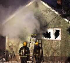 Fire crews battle a house fire in St. Boniface early this morning.